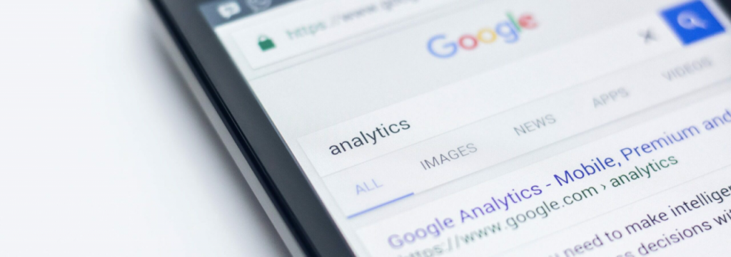 phone screen with google analytics search results